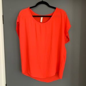 Francesca's red orange blouse